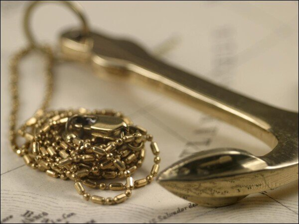 Beautiful anchor on the necklace made of shiny brass | Carol and Me