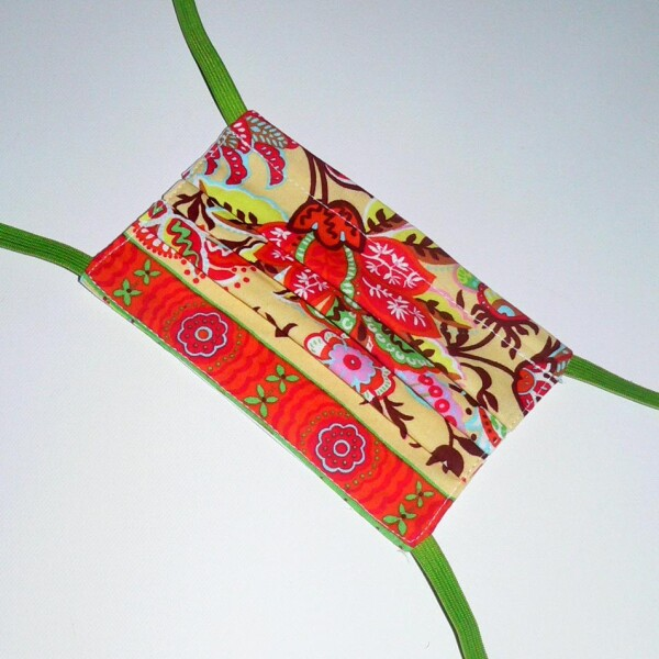 Children's mask for binding with floral pattern orange green | Eva Brachten Modedesign